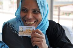 Why do you think this woman is so happy? Because she received her National ID card on the first possible day for Egyptian women to receive identity cards as part of the Women's Citizenship Initiative in the Banha District, Qalyoubia governorate, Egypt, 4 July 2012. The project aims at issuing 2 million ID cards for Egyptian women. Such ID cards are essential in providing access to certain legal, social and economic rights to women. Photo: UN Women/ Fatma Elzahraa Yassin
