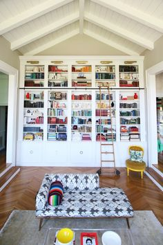 Floor to ceiling bookshelves with a library ladder...what's not to like?