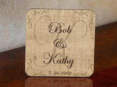 Personalized wedding coasters feature bride and groom's first names, family initial and wedding date.  Makes a great wedding or anniversary gift.  Coasters are made of durable hardboard with cork backing.  Includes slotted mahogany coaster rack for storage and display.