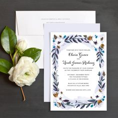 Winter florals wedding invitation by Idlewild co. featuring watercolor blooms and gorgeous colors.