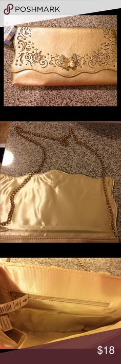 NWT Cinderella evening bag 🎀 Gorgeous gold Cinderella evening bag! Bought for my wedding and never used it. Can be used as a clutch or a purse with the chain strap. Sparkly gold butterfly and glass slipper details pictured, really pretty bag! One zip pocket inside. Still with original tag attached from Disney, great for the holidays! 🎀 Disney Bags Clutches & Wristlets