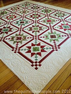 Christmas quilt. Elegantly simple. This pattern looks like Country Charmer by Sew'n Wild Oaks but with a plain white border to showcase the quilting.