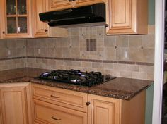 Baltic Brown Granite Tile Backsplash- prob a lighter granite and stainless  appliances, but I