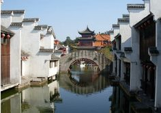 Chinese ancient fishing village buildings, quaint artistic.