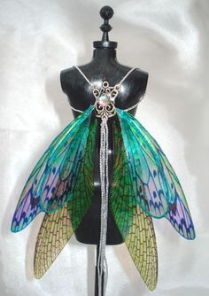 Butterfly wings http://www.anndesigns.co.uk/ebay_images/wings-bjd-001c.jpg