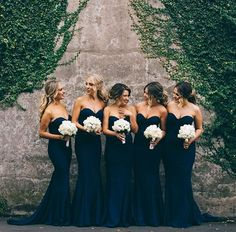 Bridesmaids' picture coming your way! This pretty lineup of bridesmaids in strapless dark blue gowns from @whiterunway really took our breath with its elegance! Posh, glamorous, and so pretty! Tag your fellow bridesmaids and find out what they think about this! Bridesmaids Dresses @whiterunway / Flower @marialushfloraldesigner / Event Planner @nightingalesweddings / Filmography @untitledfilmworksweddings / MUA @milanijoymakeup / Hair @natalieannehair / Photography @simon_gorges