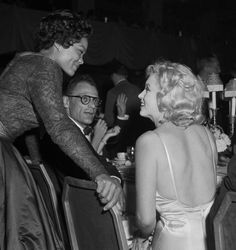 Marilyn photographed meeting Eartha Kitt, 1957