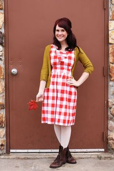 Love the red / white patterned dress with tights & boots (via A Beautiful Mess)