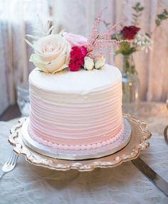 Pink white ombre covering with fresh flower topping. Pretty!