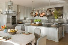 kitchen in Meadowmere Southampton home by Carrier and Company