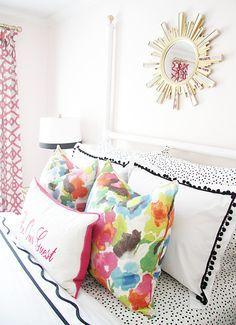 guest room, colorful, floral pillow, sunburst mirror