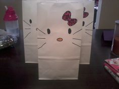 Handmade Hello Kitty favor bags...colored by the birthday girls themselves!