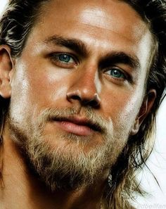 Charlie Hunnam... lose the beard and he would be fiiiiiine! look at those cheek bones