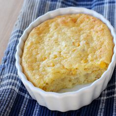 Corn Pudding. 1 (15.5 ounce) can whole corn (drained), 1 (15 ounce) can cream style corn, 1/4 cup butter (melted), 1 (8.5 ounce) corn muffin mix,1 c sour cream, 4 oz cream cheese, 3/4 cup shredded cheddar cheese, 3 eggs. Mix together and bake at 375 for 45 mins.