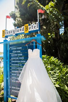Wedding dress hanging on a sign at the Disneyland Hotel