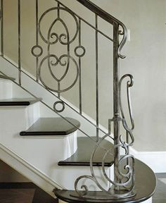 Wrought-Iron Railing... what if we just paint current railing and give it a new handrail of stained wood?