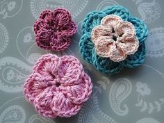 Overlapping 6 petal flowers in different colors-free pattern