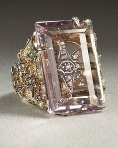 holy amazeballs h. stern ring | octagonal stars of inlaid diamonds and amethyst stone.