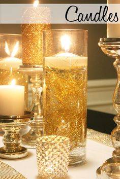 Floating candles in a hurricane candle holder for wedding table decorations. Would use silver instead of gold.