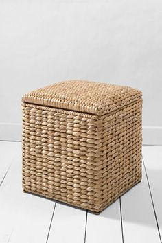 Seagrass storage cube--fits beneath a window sill and artfully hides bed linens.  Also gives guests a place to sit a bag in a guest room.