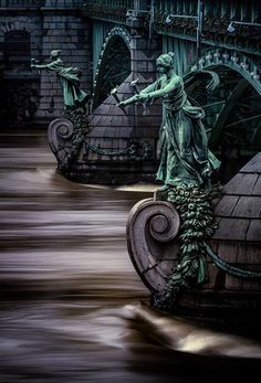 Torchbearers on the pillars of the bridge of Svatopluk Čech, Prague. This bridge is the srortest one in Prague.