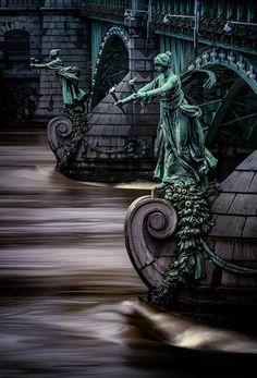 Torchbearers on the pillars of the bridge of Svatopluk Čech, Prague, Czechia