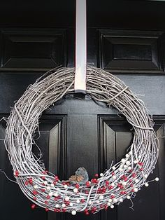 I like the idea of painting the grapevine wreath white but I would add way more stuff to it.