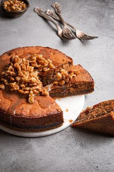 This fig cake is loaded with molasses, spices, and fig paste, it is the perfect soft and tender companion to a crumbly and buttery oat crust. And in addition, to bring it all to a perfect harmony  are some walnuts in honey syrup. |#figcake #figrecipe #driedfigrecipe #cakerecipe #walnutshoney #honeywalnutsyrup #tubishvatrecipe #tubishvatplate #driedfruit #figpaste #molassesrecipe #molassescake #moistpoundcake #tendercake|