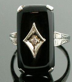 Antique  18k White Gold Black Onyx and Diamond Ring. $875.00, via Etsy.