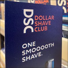 Dollar Shave Club Bottom-Mount Sign Holder Dollar Shave Club, Retail Fixtures, Tidy Up, Visual Merchandising, Shaving, Orange, Signs, Color, Shop Signs
