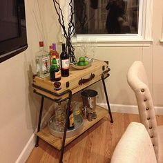 The find: this fun bar cart styled after vintage luggage.