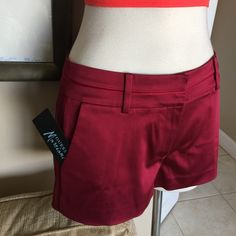 GUESS by GEORGE MARCIANO Wine Satin Shorts 4 NWT GUESS by GEORGE Marciano Couture line of Guess New with tags Wine Burgundy Red satin Polyester Flat front trouser shorts hot pants. Has belt loops and real slash back pockets.   Size 4. Inseam is 2 inches, Rise is 6 inches. Sits just below the waist. Retail price was $124. Please. No low balls, your already getting a screaming deal! I do not expect these to last long. Guess by Marciano Shorts