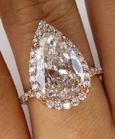 SUPER Elegant IMPORTANT Timeless Micro Pave 14K Rose Gold (tested) Diamond Halo PEAR Diamond ring from our Estate Collection. The Center diamond