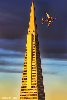 Top Of Transamerica Pyramid In Golden  Light With Commercial Airplane, San Francisco By Mitchell Funk   mitchellfunk.com