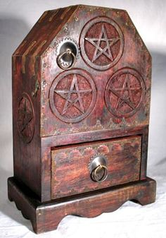 "Pentagram Chest Bedecked with the accents of metal buckles and multiple pentagrams, this chest and cupboard piece is a beautiful addition to any altar, providing much needed storage space. This piece measures 11"" by 7 5/8"" by 4 1/2"" overall."