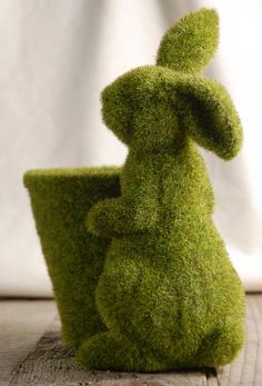 moss covered bunny. Perfect project for those cement lawn ornaments leftover from the previous home owners