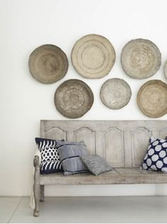 Love the pottery on the wall for a kitchen or dining area. Neutrals.