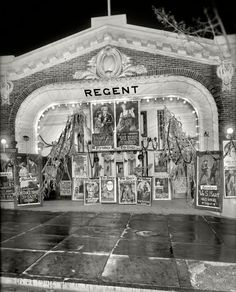 "October 1920. Washington, D.C. ""Lust's Regent."" Theater impresario Sidney Lust's 18th Street cinema decorated for Halloween with an array of eye-catching movie posters."