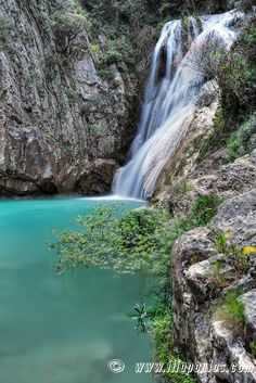 This is a waterfall called Polylimnio. It is located in Greece and is really pretty.