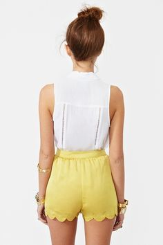 yellow scallop shorts.