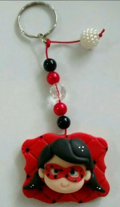 Chaveiro de biscuit lady bug