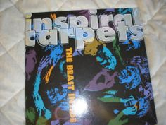 INSPIRAL CARPETS THE BEAST INSIDE 1991 MUTE DUNG 14 Vinyl LP album http://r.ebay.com/EHa1sl  Hard to find 90s vinyl  Inspiral Carpets are an alternative rock band from Oldham in Greater Manchester, England formed by Graham Lambert and Stephen Holt in 1983.[1] Their sound is based around psychedelic organs and guitars Came to prominence, like The Stone Roses and Happy Mondays, in the 'Madchester' scene of the late 1980s Brit Pop