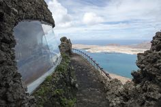 https://flic.kr/p/EykttE | Mirador del Río | Architect: César Manrique, Jesús Soto & Eduardo Cáceres, 1971-1973  The Mirador del Río is a panoramic viewpoint and restaurant, embedded at the top of a steep cliff in the north of Lanzarote, overlooking the island of La Graciosa and the narrow straits between the two islands (nicknamed El Río).  Originally the site of a small gun battery, the top of the cliff has been excavated and the new spaces inserted under a cover of volcanic stone, in ...