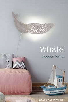 Majestic Blue whale lamp on your wall?This wooden wall lamp looks great both day and night. It will please everyone's eye..In one of 16 colours of our water-based non toxic paints it will fit every interior!Perfect decor for a nautical nursery. #modernlamps #nurserylamp #prettylamps #lampprojects #lampdecor #nauticalnursery, #nauticaldecor, #walllamp, #pendantlamp, #whalelamp, #bluewhale, #lampdeign, #boholamp Wooden Wall Lights, Wooden Chandelier, Wooden Walls, Nautical Lamps, Nautical Nursery, Creative Lamps, Unique Lamps, Nursery Lamps, Bedroom Lamps