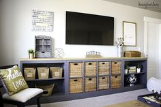 Time to take a visit over to Honeybear Lane where we are going to learn how to turn an IKEA Expedit into a Long Farmhouse Style Storage Unit that is picture perfect for a Family Room You need to check this out…wonderful for families with kids because there is a place for just about everything …