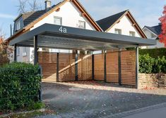 MyPort double carport with wooden wall panels - This double carport offers enough space for two vehicles. The wooden wall panels also offer protect - Carport Modern, Double Carport, Garage Double, Carport Garage, Pergola Carport, Diy Pergola, Garage Doors, Diy Garage, Pergola Ideas