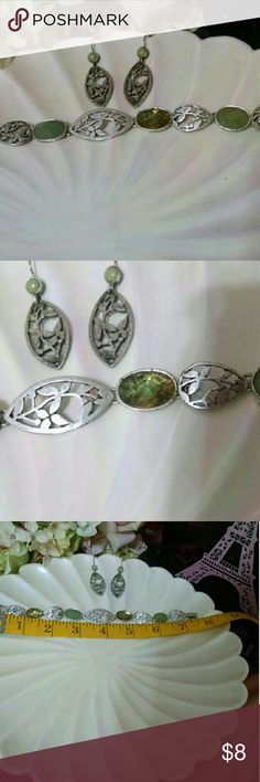 """Silvertone bracelet and earrings set 7.5"""" bracelet with leaf design and ametrine and abalone like stones (they are not genuine I think they are resin) and coordinating leaf earrings. First offer adds these to her collection! Jewelry Bracelets"""