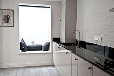 Black & White family kitchen with bespoke window seat
