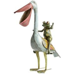 OMG i am obsessed with this little guy. He's a NECESSITY for out here o the lake!! Even cuter (brighter colors) in person. Pelican With Frog