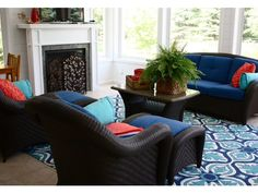 Navy blue, teal and coral for sunroom or outdoor space.